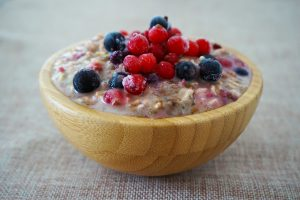 overnight oats in a bowl topped with berries